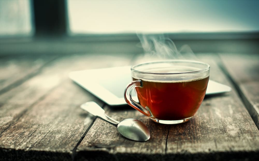 Hot tea cup on a frosty winter da