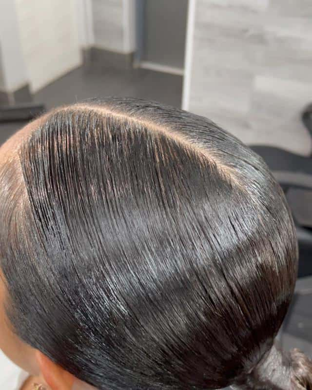 Sleek Ponytail With Center Parting 2